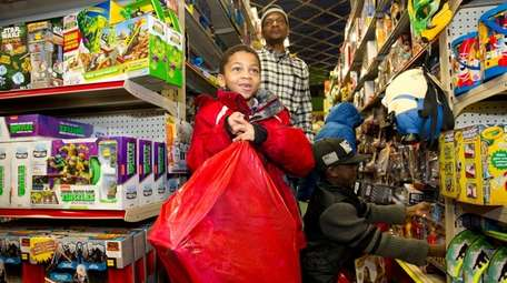 Children grab some toys as the Nassau County