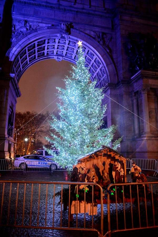 NYPD officers guard the Christmas display at Grand