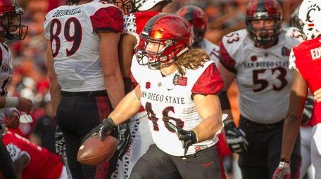 San Diego State fullback Dakota Gordon (46) emerges