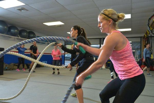 Brandi Ullrich, right, of Huntington, uses long ropes
