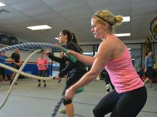 Brandi Ullrich, right, of Huntington, uses long ropes