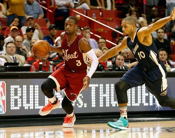 Miami Heat's Dwyane Wade (3) brings the ball