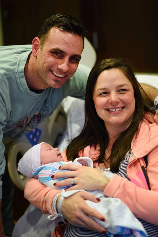 Karyn and Vic Faster with their newborn, Nicholas,