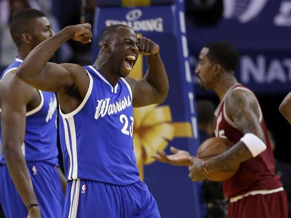 Golden State Warriors' Draymond Green (23) celebrates after