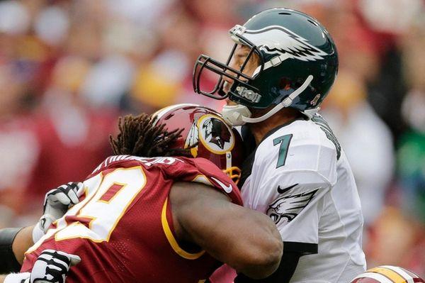 Eagles quarterback Sam Bradford takes a shot in