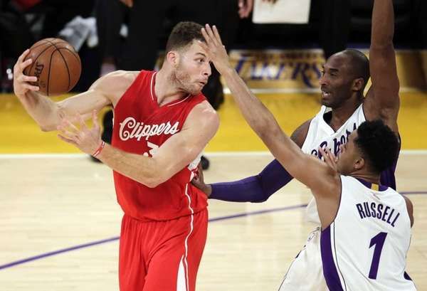 Los Angeles Clippers forward Blake Griffin, left, passes