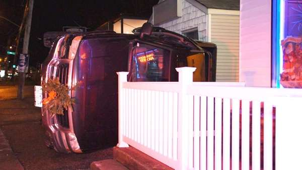 A sport utility vehicle rests on its side