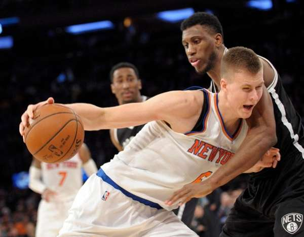 Knicks forward Kristaps Porzingis, left, admits that it's