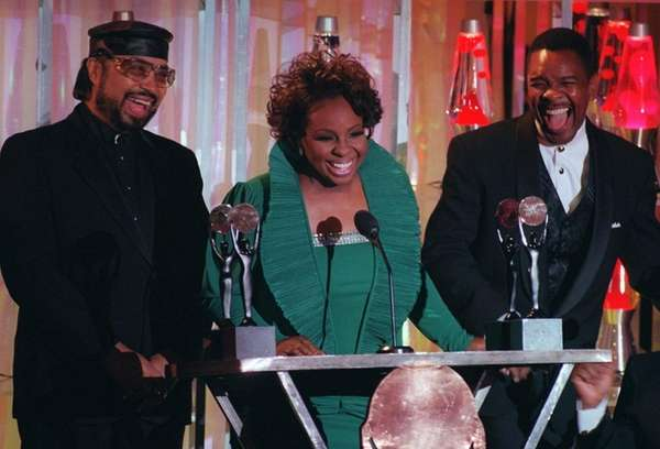 Gladys Knight, flanked by William Guest, and Merald