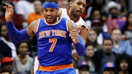 New York Knicks' Carmelo Anthony, left, reacts after