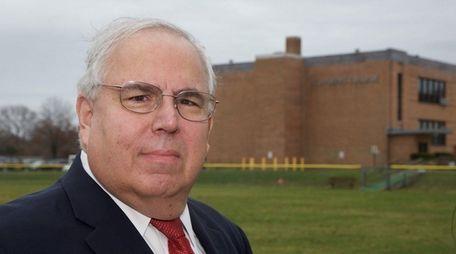 Jack Calareso, president of St. Joseph's College, stands