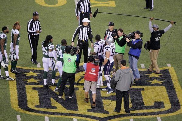 The officials meet New York Jets' Darrelle Revis
