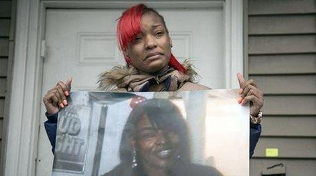 Latonya Jones, 19, holds a photo of her