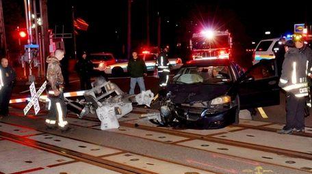 Emergency personnel surround a car that broke through