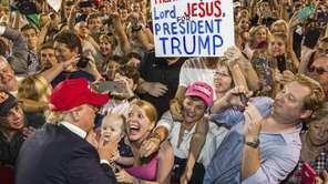 Republican presidential candidate Donald Trump greets supporters after