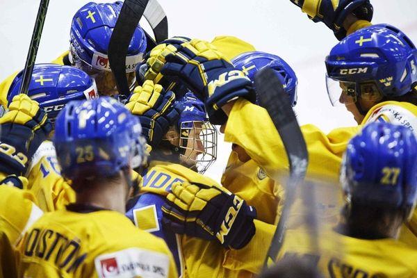 Alexander Nylander, center, of Sweden and teammates celebrate