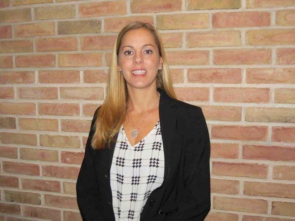 Carisa Burzynski of Farmingdale has been appointed interim