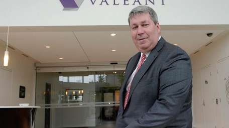 Valeant Pharmaceuticals CEO J. Michael Pearson poses at