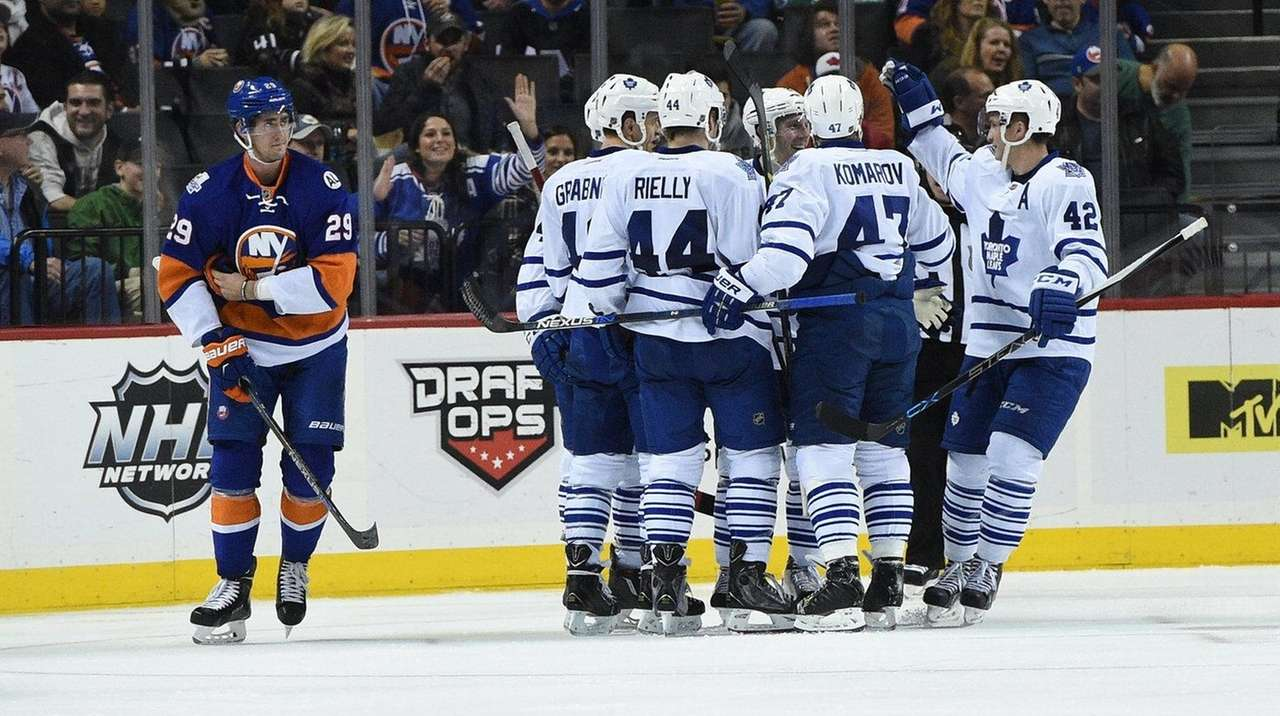 The Toronto Maple Leafs celebrate a goal by