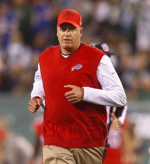 Head coach Rex Ryan runs off the field