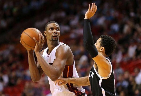 Chris Bosh #1 of the Miami Heat shoots