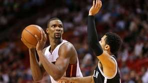 Chris Bosh #1 of the Miami Heat shoots