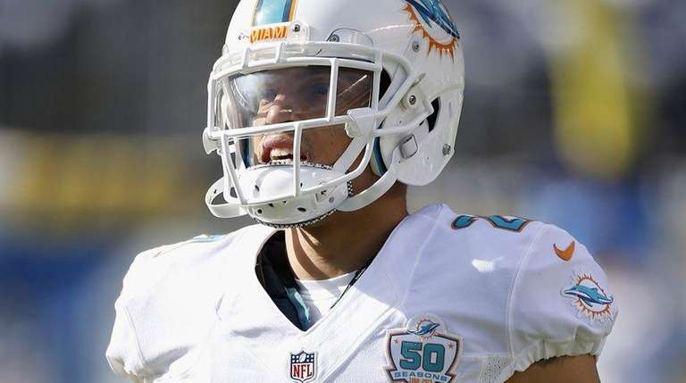 Miami Dolphins cornerback Brent Grimes warms up before