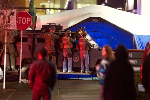 SWAT team members wait outside the Clackamas Town
