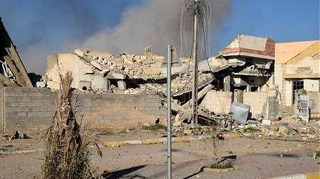 Smoke rises over destroyed Islamic State positions following