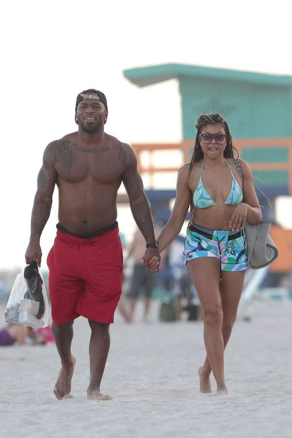 Actress Taraji P. Henson holds hands with NFL