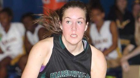 Harborfields' Kate Tardo (5) brings the ball up
