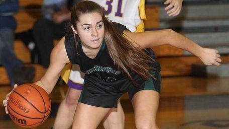 Harborfields' Angela Deren (14) plays the ball in