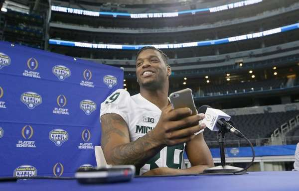 Michigan State defensive end Shilique Calhoun (89) smiles