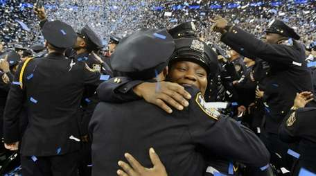 Newly-sworn in NYPD officers are showered with confetti