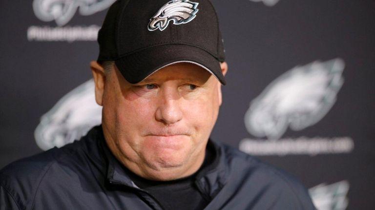 Philadelphia Eagles coach Chip Kelly listens to