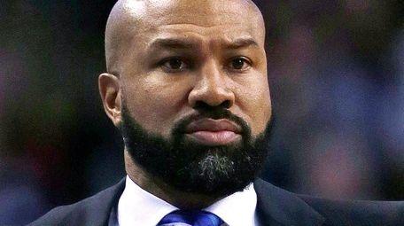 New York Knicks head coach Derek Fisher instructs
