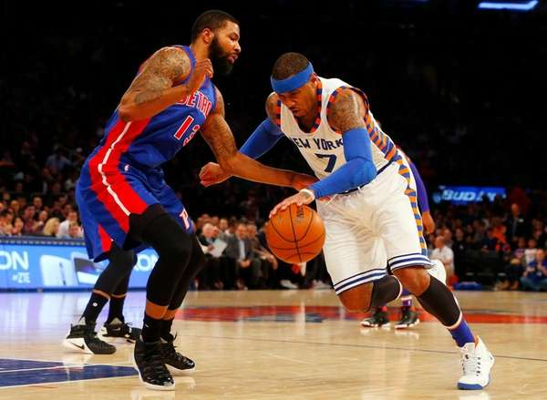 Carmelo Anthony drives to hoop against Pistons forward