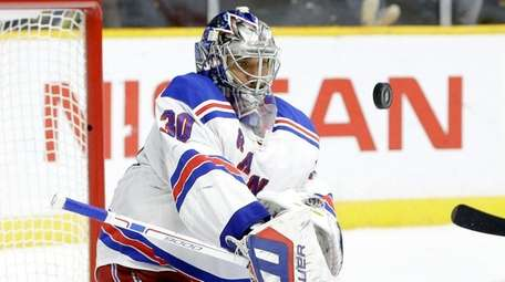 New York Rangers goalie Henrik Lundqvist (30) blocks