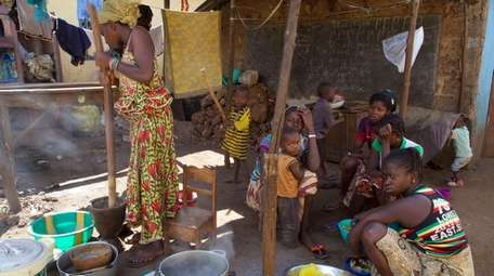 People prepare food at a home stead in