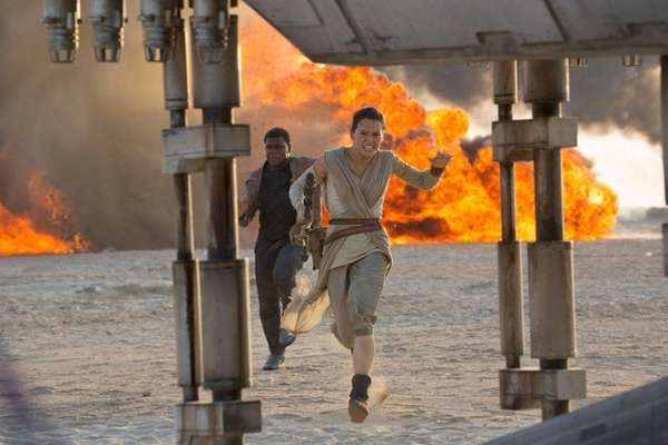Daisy Ridley, foreground, and John Boyega appear in