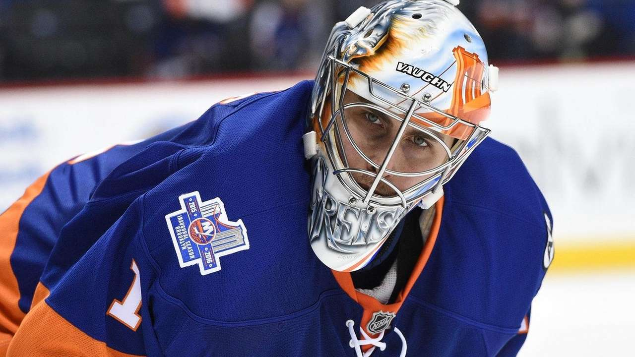 New York Islanders goalie Thomas Greiss looks on
