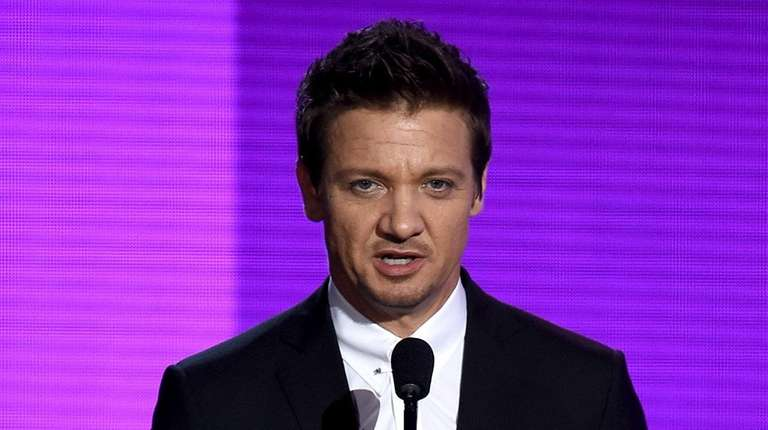 Actor Jeremy Renner presents an award during the
