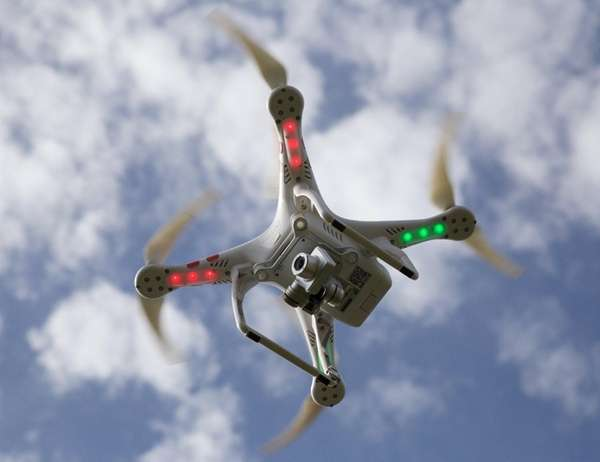 A model drone flies over Farmingdale on Sept