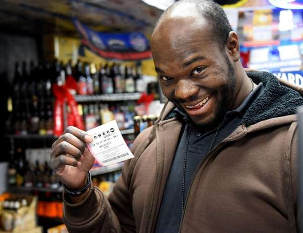 Chris Okolie, 30, of Dix Hills, purchases a