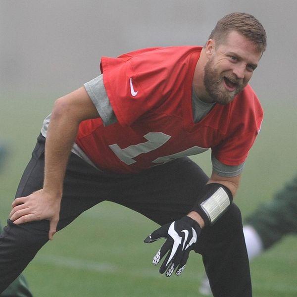 Ryan Fitzpatrick #14 New York Jets quarterback laughs