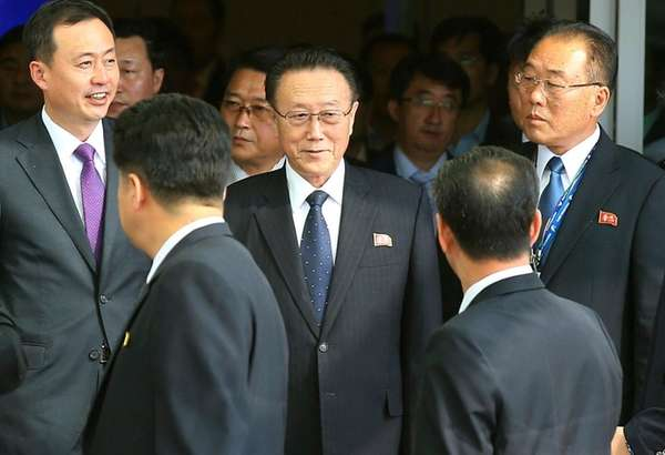Kim Yang Gon, center, a secretary of North