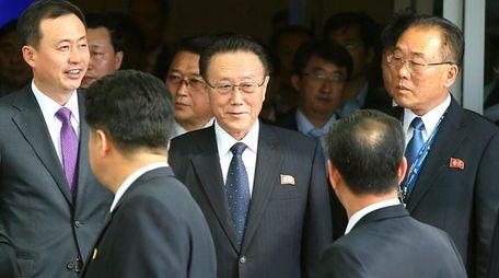 Kim Yang Gon, center, a secretary of North
