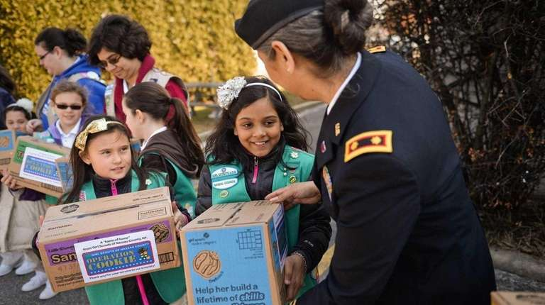 Girl Scouts Isabella Yew, 9, of Hicksville, left,