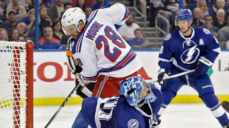 Rangers' Dominic Moore tucks the puck past Lightning
