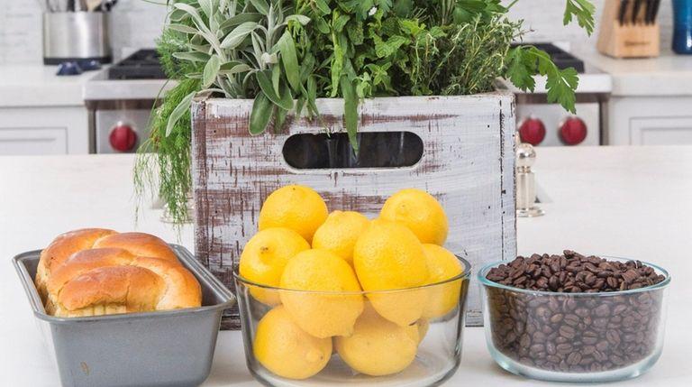An herb box, fresh baked bread, lemons and